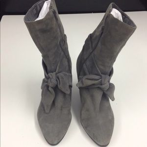 Mid calf grey suede boot with front ties